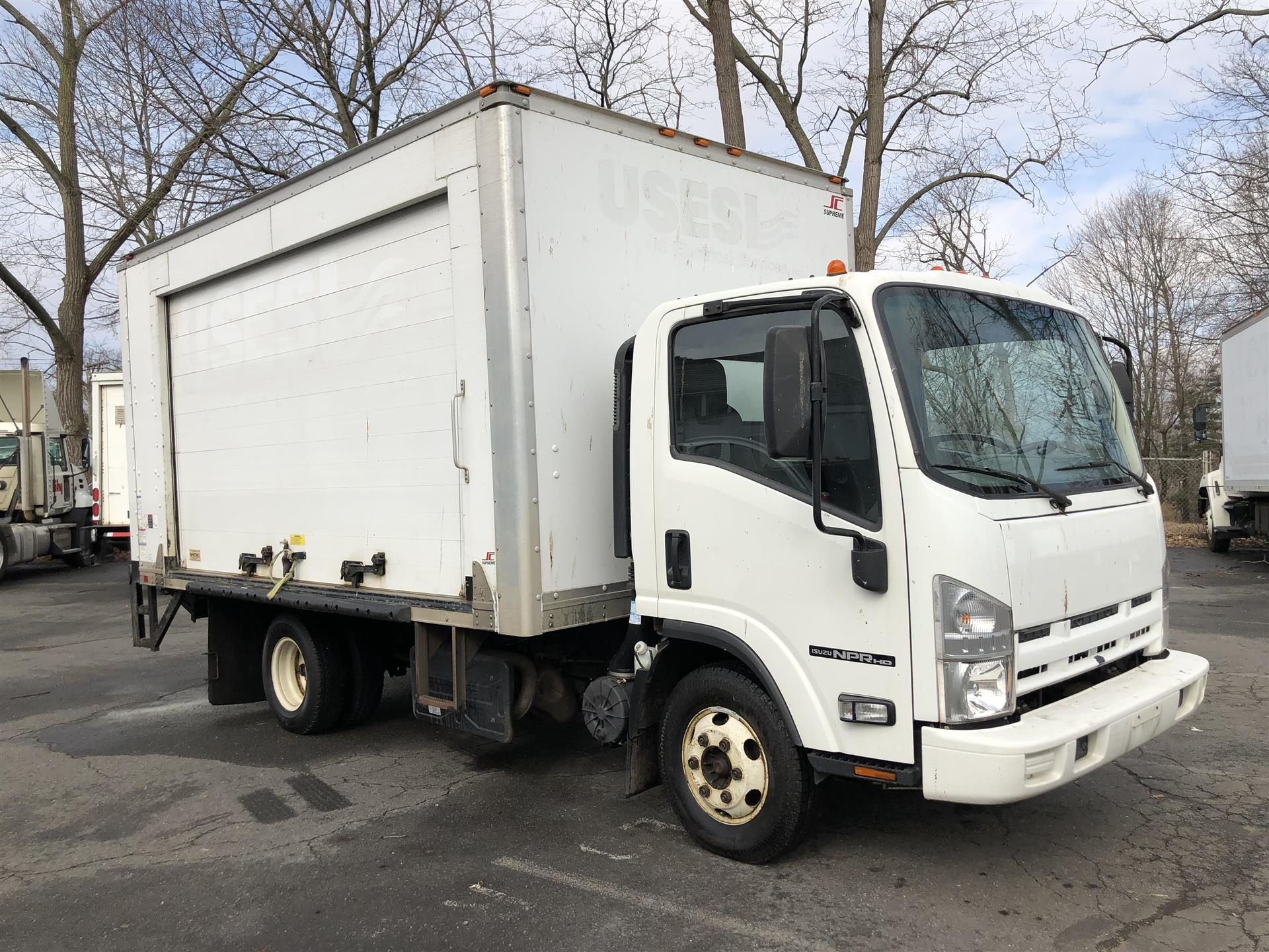 Used Isuzu Box Truck Roll Up Curb Side